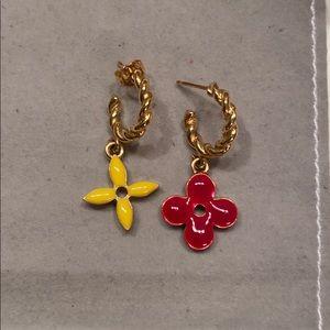 Luis Vuitton mismatched earrings